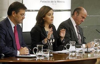 Rafael Catalá, Soraya Sáenz de Santamaría y Luis de Guindos (Foto: Pool Moncloa)
